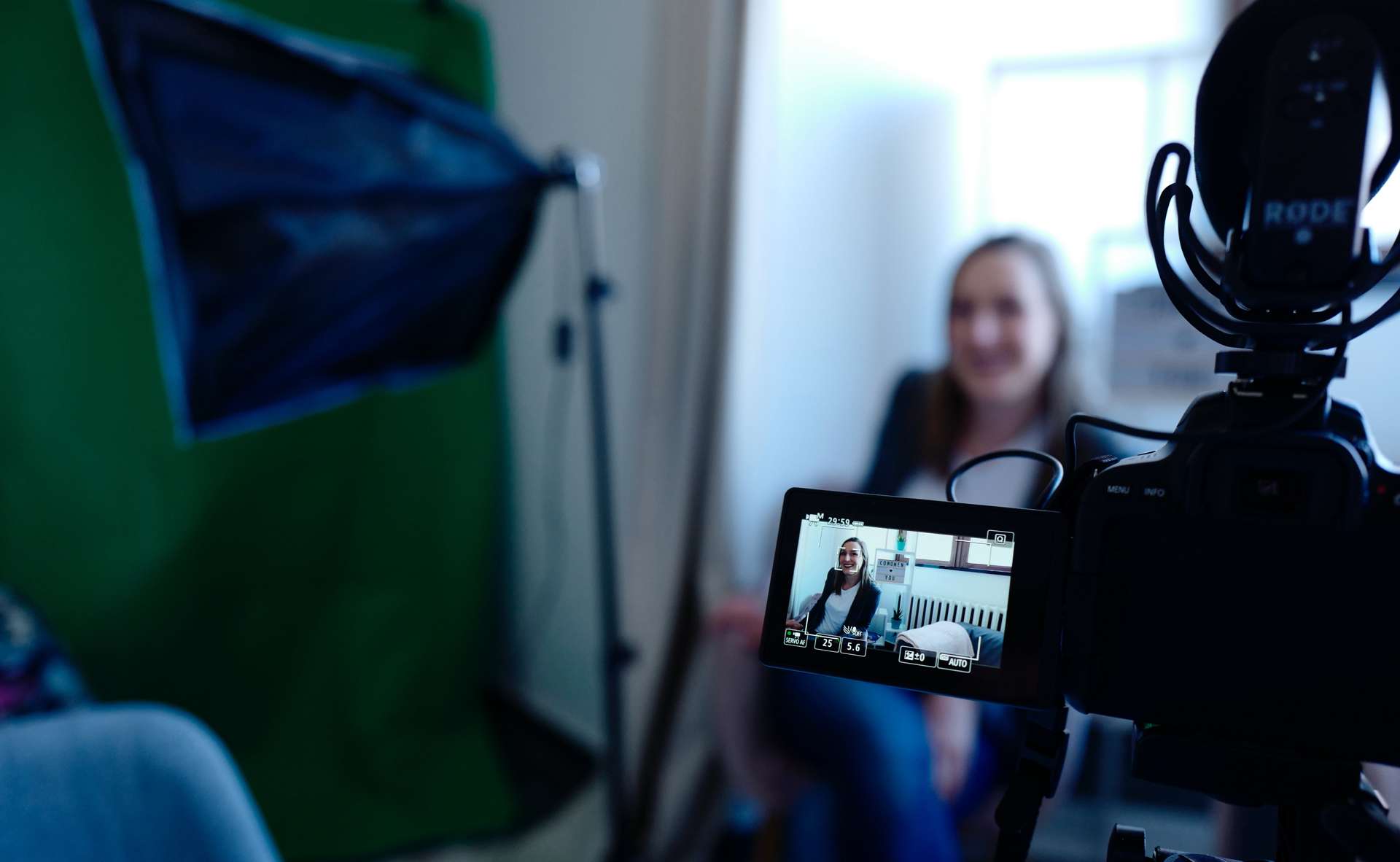 filming an interview on a video camera